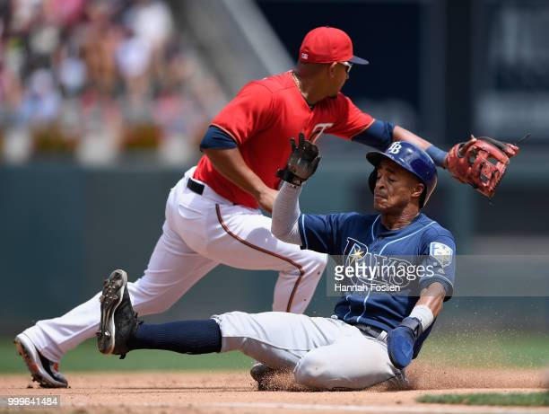 Mallex Smith of the Tampa Bay Rays slides safely into third base as Eduardo Escobar of the Minnesota Twins fields the ball during the fourth inning...