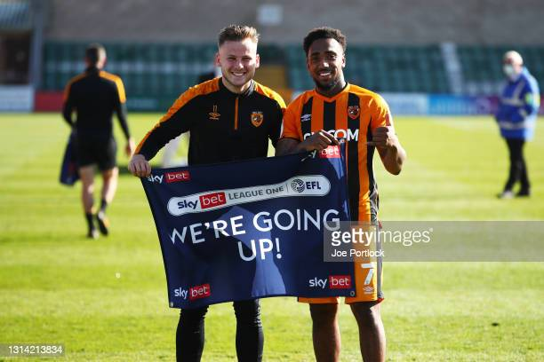 Mallik Wilks of Hull City and James Scott during the Sky Bet League One match between Lincoln City and Hull City at Sincil Bank Stadium on April 24,...