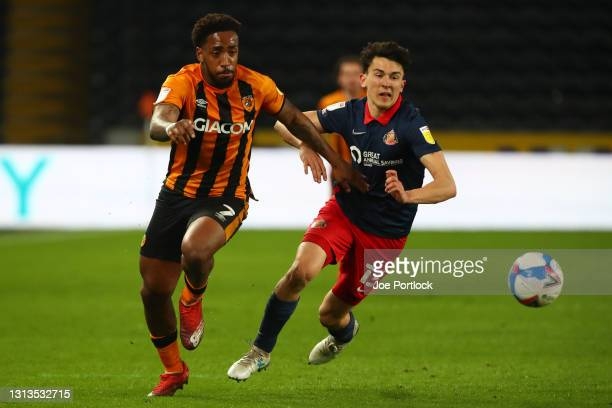 Mallik Wilks of Hull City and Luke O'Nien of Sunderland in action during the Sky Bet League One match between Hull City and Sunderland at KCOM...