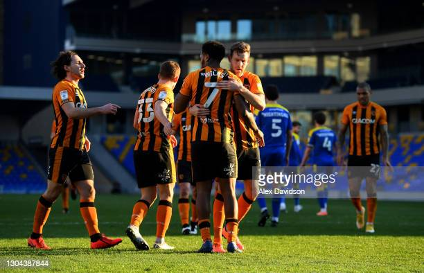 Mallik Wilks of Hull City celebrates with Callum Elder after scoring their team's third goal from the penalty spot during the Sky Bet League One...