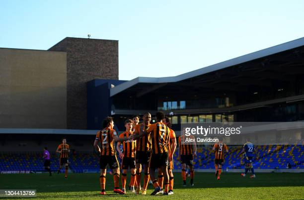 Mallik Wilks of Hull City celebrates with teammates after scoring their team's third goal from the penalty spot during the Sky Bet League One match...