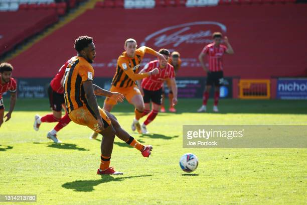 Mallik Wilks of Hull City scores during the Sky Bet League One match between Lincoln City and Hull City at Sincil Bank Stadium on April 24, 2021 in...