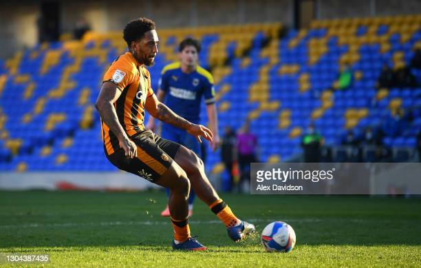 Mallik Wilks of Hull City scores their team's third goal from the penalty spot during the Sky Bet League One match between AFC Wimbledon and Hull...