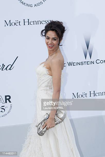 Mallika Sherawat attends amfAR's Cinema Against AIDS Gala during the 64th Annual Cannes Film Festival at Hotel Du Cap on May 19 2011 in Antibes France