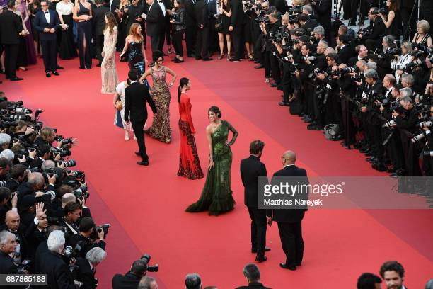 Mallika Sherawat Liu Wen and Iris Mittenaere attend the 'The Beguiled' screening during the 70th annual Cannes Film Festival at Palais des Festivals...