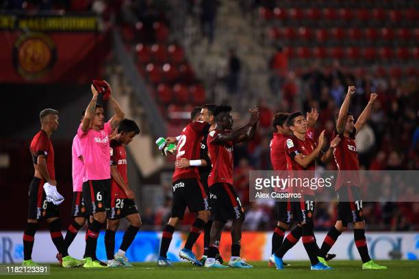 Mallorca players celebrate victory after the La Liga match between RCD Mallorca and Real Madrid CF at Iberostar Estadi on October 19 2019 in Mallorca...