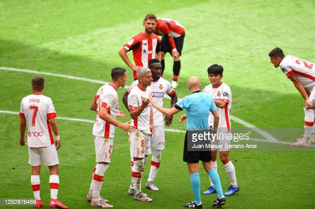 Mallorca players protest a penalty resulting to Raúl García of Athletic Club scoring the opening goal during the Liga match between Athletic Club and...
