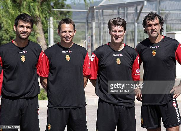 Mallorca's Danish coach Michael Laudrup poses with Miguel Angel Nadal uncle of Rafael Nadal and member of Mallorca's technical staff and other team...