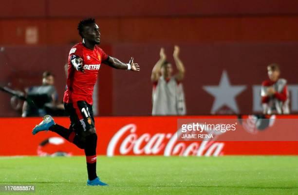 Mallorca's Ivorian midfielder Lago Junior celebrates a goal during the Spanish league football match RCD Mallorca against Real Madrid CF at the...