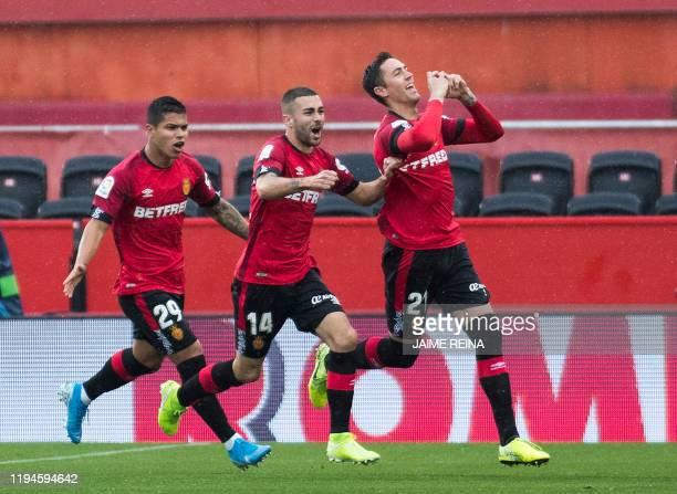 Mallorca's Spanish defender Antonio Jose Raillo celebrates after scoring a goal during the Spanish league football match between RCD Mallorca and...