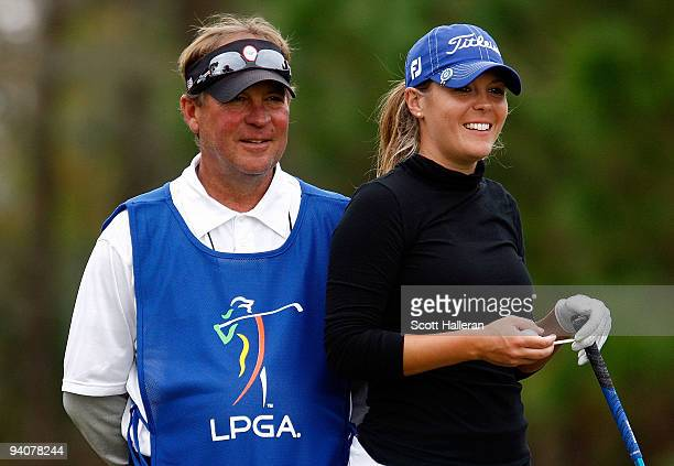 Mallory Blackwelder waits with her father/caddie Worth during the fourth round of the 2009 LPGA Qualifying Tournament at LPGA International on...