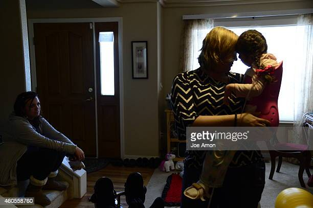 October 03: Mallory Johnson visits with Janéa Cox, director of the Flowering H.O.P.E. Foundation, as she picks up CBD oil for her daughter Zoey....