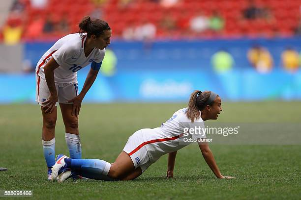Mallory Pugh and Carli Lloyd of United States react during the Women's Football Quarterfinal match against Sweden at Mane Garrincha Stadium on Day 7...