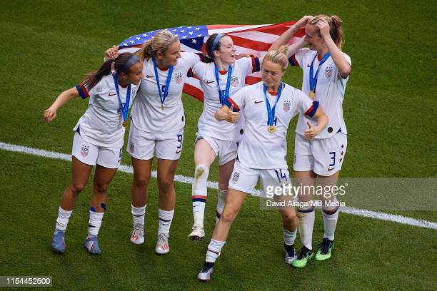 Mallory Pugh Lindsey Horan Rose Lavelle Emily Sonnett and Samantha Mewis of the USA celebrate the victory with the USA flag during the 2019 FIFA...