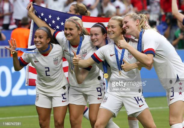 Mallory Pugh Lindsey Horan Rose Lavelle Emily Sonnett of USA celebrate the victory following the 2019 FIFA Women's World Cup France Final match...