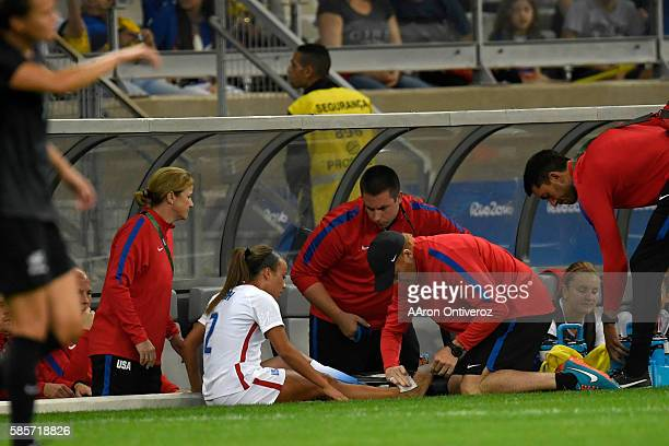 Mallory Pugh of the United States takes a moment to get medical attention against New Zealand during the first half of their first round Rio 2016...