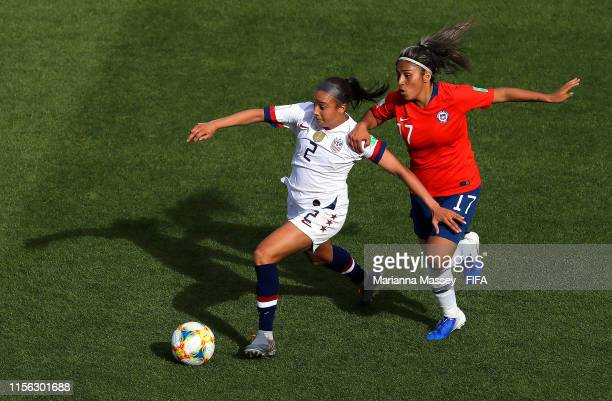 Mallory Pugh of the USA is challenged by Javiera Toro of Chile during the 2019 FIFA Women's World Cup France group F match between USA and Chile at...