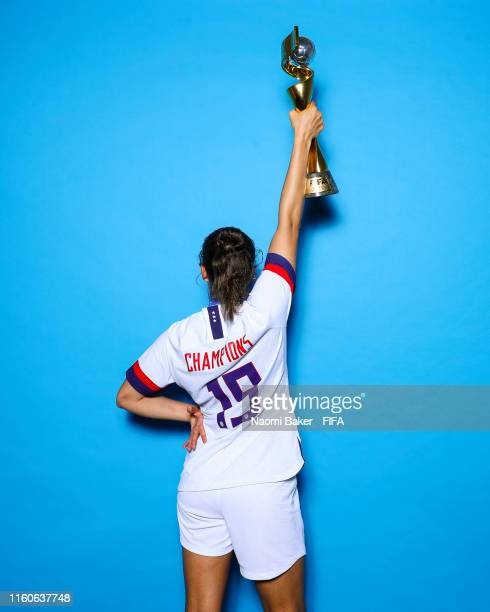 Mallory Pugh of the USA poses with the Women's World Cup trophy after the 2019 FIFA Women's World Cup France Final match between The United State of...