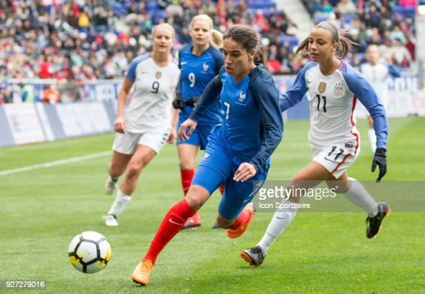Mallory Pugh of the USWNT follows up behind Amel Majri of France during a She Believes Cup match between the USWNT and France on March 04 at Red Bull...