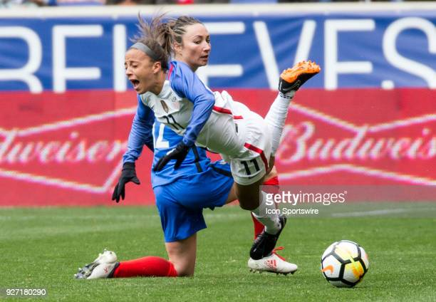 Mallory Pugh of the USWNT is fouled by Gaetane Thiney of France during a She Believes Cup match between the USWNT and France on March 04 at Red Bull...