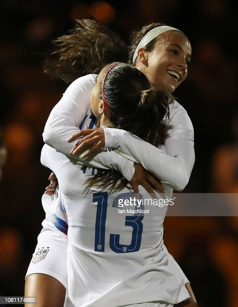 Mallory Pugh of United States congratulates team mate Alex Morgan after she scores the opening goal during the Women's International Friendly match...