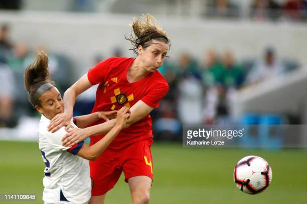 Mallory Pugh of United States Women's National Team and Heleen Jaques of Belgian Women's National Team fight for control of the ball during the first...