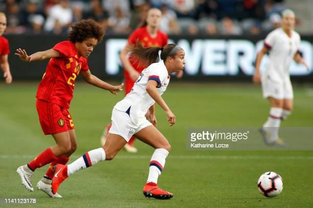 Mallory Pugh of United States Women's National Team dribbles the ball around Kassandra Missipo of Belgian Women's National Team during a game at Banc...