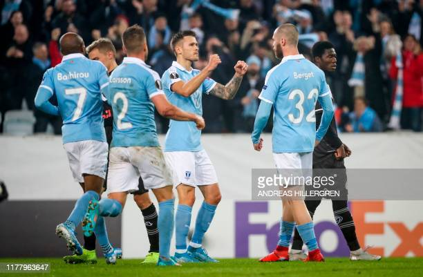 Malmö FF's Norwegian forward Jo Inge Berget celebrates with teammates scoring during the UEFA Europa League group B football match between Malmo FF...