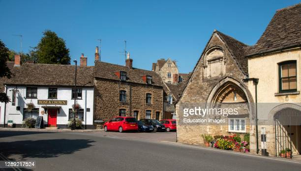 Malmesbury, Wiltshire, England, UK, A medieval 12th century arched doorway formerly a part of the hospital of St John the Baptist with 17th century...