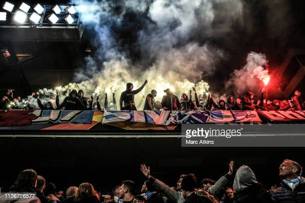 Malmo fans set off flares during the UEFA Europa League Round of 32 Second Leg match between Chelsea and Malmo FF at Stamford Bridge on February 21...