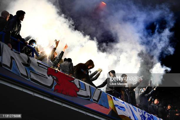 Malmo FF fans let off flares at the start of the second half during the UEFA Europa League Round of 32 Second Leg match between Chelsea and Malmo FF...