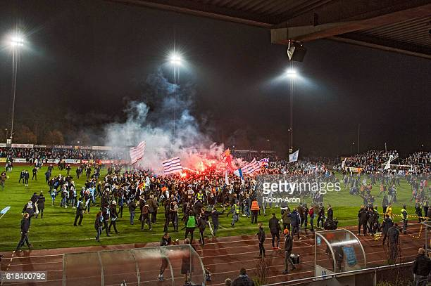 Malmo FF fans storms the field and celebrates first place in the Swedish league after the victory in the Allsvenskan match between Falkenbergs FF and...