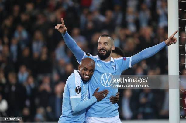 Malmo FF's Swedish midfielder Guillermo Molins celebrates with Malmo FF's Comorian midfielder Fouad Bachirou after scoring during the UEFA Europa...