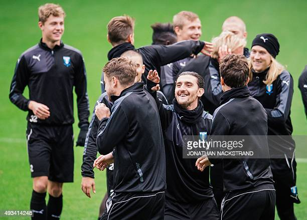 Malmo players takes part in a training session at the Swedbank Stadion on October 20 on the eve of the UEFA Champions League Group A football match...