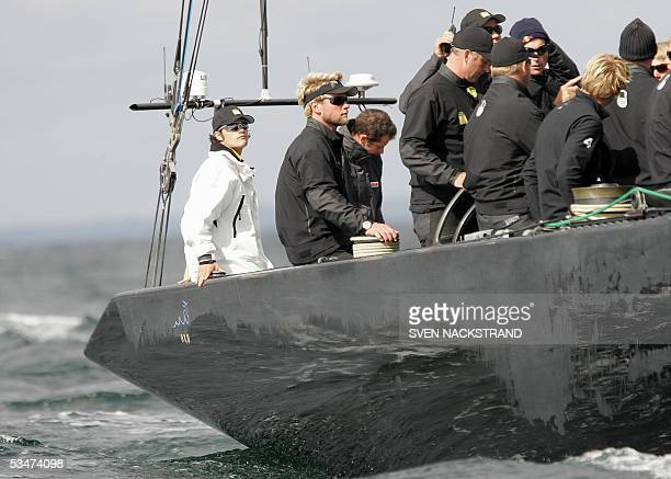 Swedish Prince Carl Philip of Sweden who for the day is sailing as the 18th man aboard the Swedish yacht Victory Challenge sits in the stern while...