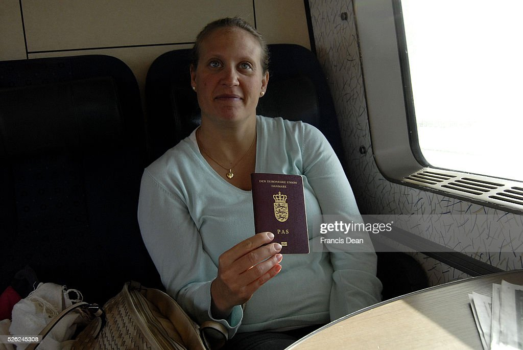 Danes with passport crossing from copenhagen to Malmo sweden : News Photo