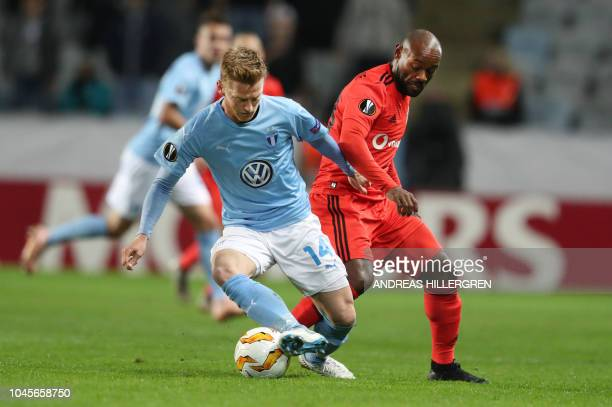 Malmo's Anders Christiansen and Besikta's Vagner Love vie for the ball during the UEFA Europe League Group I football match Malmo FF v Besiktas in...