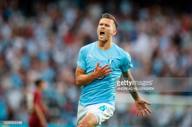 Malmo's Arnor Ingvi Traustason celebrates scoring the 11 goal during the UEFA Champions League second round second leg qualifying football match...