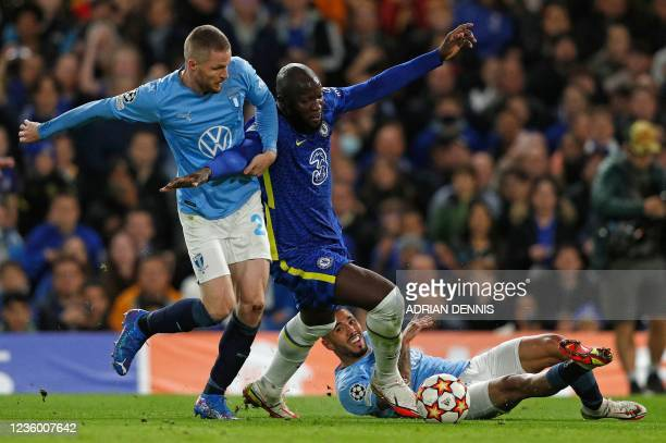 Malmo's Daniish defender Lasse Nielsen fouls Chelsea's Belgian striker Romelu Lukaku to concede a penalty during the Champions League group H...