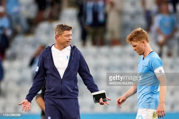 Malmo's Danish coach Jon Dahl Tomasson reacts on Malmo's Danish midfielder Anders Christiansen during the UEFA Champions League qualifying football...