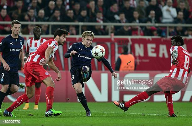Malmo's defender Anton Tinnerholm vies with Olympiakos' Spanish defender Alberto Botia during the UEFA Champions League Group A football match...