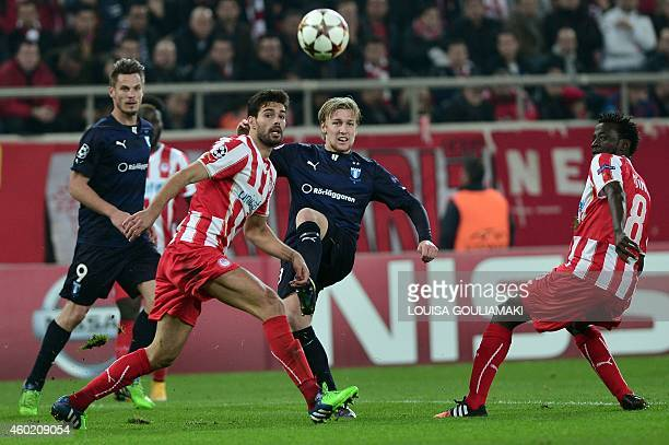 Malmo's defender Anton Tinnerholm vies with Olympiakos' Spanish defender Alberto Botia during the UEFA Champions League football match Olympiakos vs...