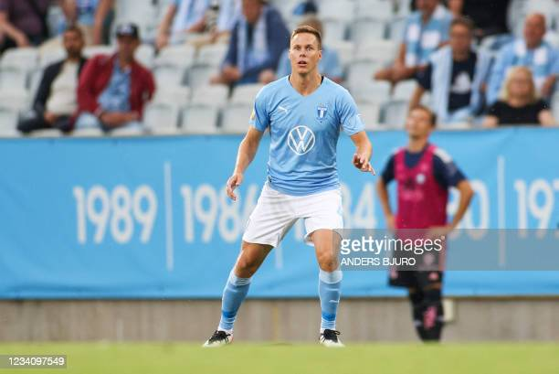 Malmo's Finnish defender Niklas Moisander reacts during the UEFA Champions League qualifying football match between Malmo and HJK Helsinki at the...