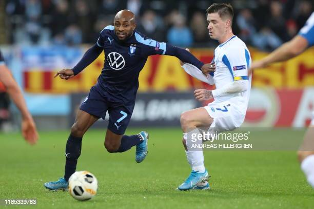 Malmo's Fouad Bachirou and Dynamo Kyiv's Benjamin Verbic vie for the ball during the Europa League football match between Malmo FF and Dynamo Kiev in...