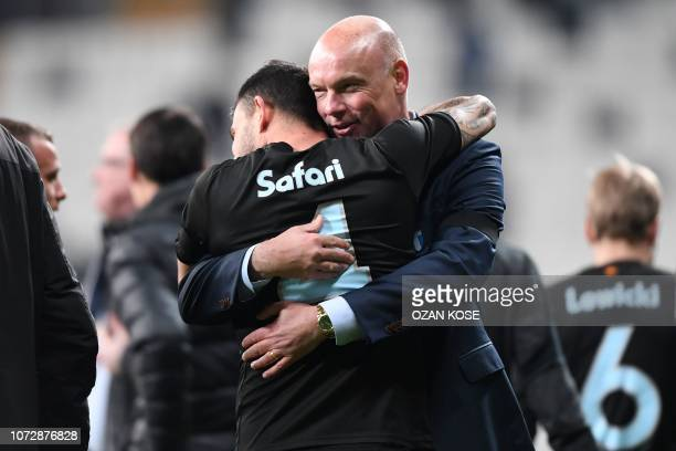 Malmo's German head coach Uwe Rosler celebrates their victory with Swedish defender Behrang Safari at the end of the UEFA Europa League Group I...