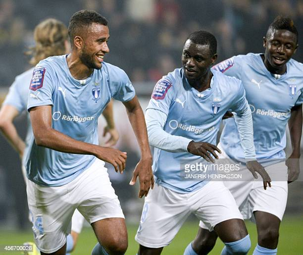 Malmo's Kiese Thelin and Enoch Kofi Adu celebrate a goal during the Swedish football league match between AIK and Malmo at the Friends Arena in Solna...