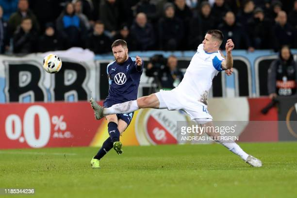 Malmo's Lasse Nielsen and Dynamo Kyiv's Artem Besedin vie for the ball during the Europa League football match between Malmo FF and Dynamo Kiev in...