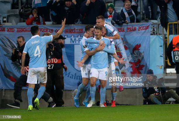 Malmo's Markus Rosenberg celebrates scoring the 11 goal with his teammates during the Europa League Group B football match Malmo FF v FC Copenhagen...