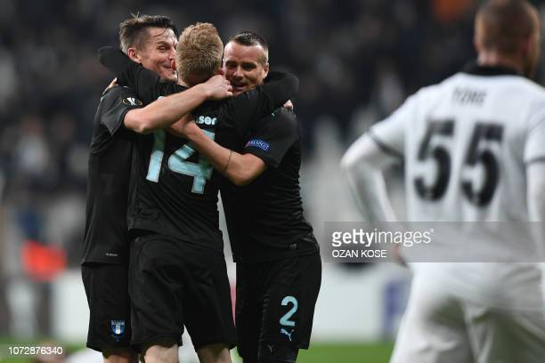 Malmo's players celebrate their victory at the end of the UEFA Europa League Group I football match between Besiktas JK and Malmo FF at the Vodafone...