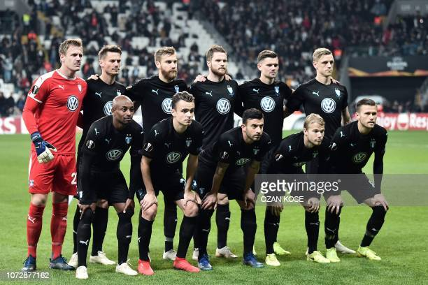 Malmo's players pose before the UEFA Europa League Group I football match between Besiktas JK and Malmo FF at the Vodafone Park stadium in Istanbul...